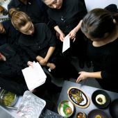 A staff meeting with Chef Debbie Lee